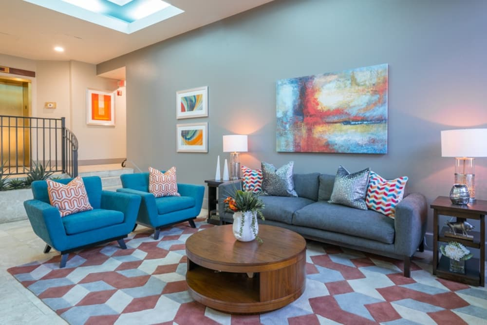 Comfortable seating in the clubhouse at The Enclave at 1550 Apartments in San Antonio, Texas