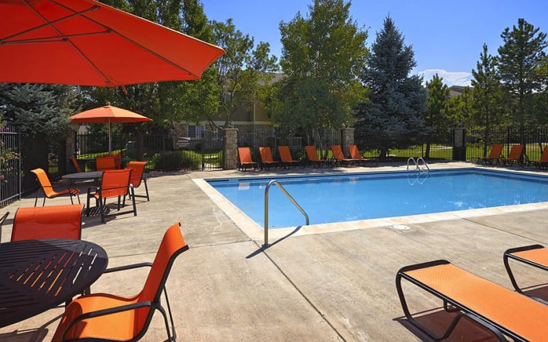Covered seating near the swimming pool at Crossroads at City Center Apartments in Aurora, Colorado