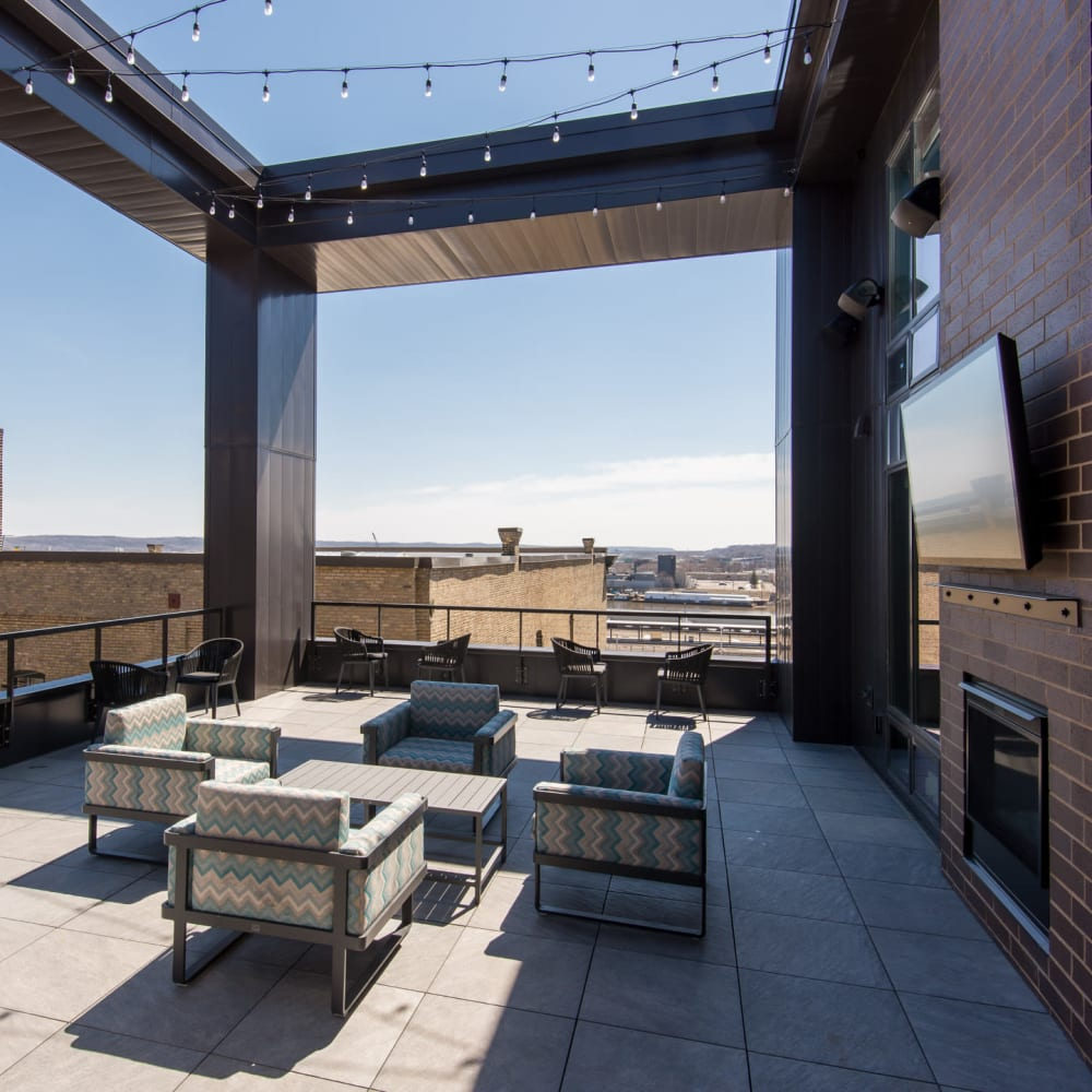 Outdoor lounge area with a fire pit on the rooftop at Oaks Union Depot in St. Paul, Minnesota