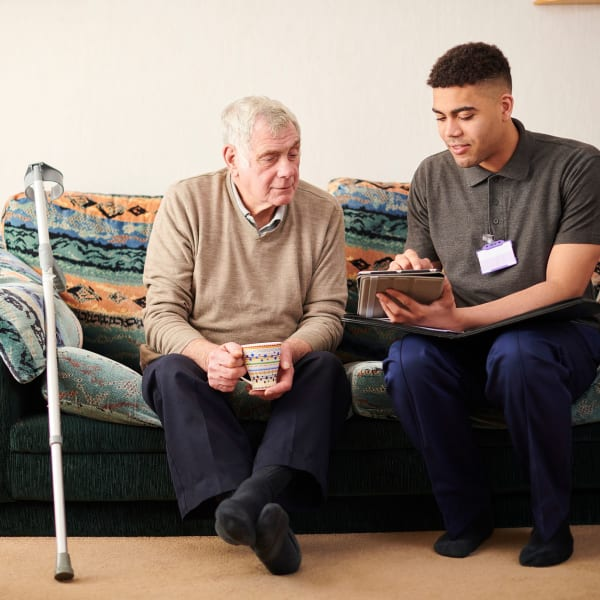 A staff member going over options with a resident at Pacifica Senior Living Menifee in Sun City, California.