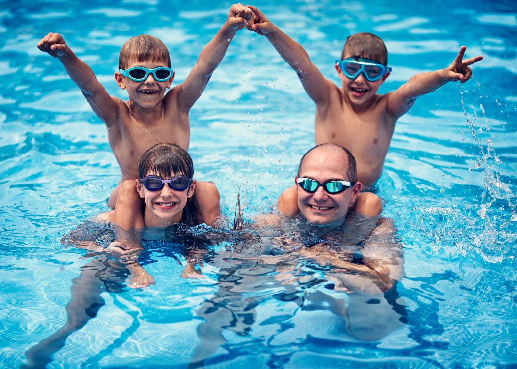A family enjoying the refreshing swimming pool at Avilla Centerra Crossings in Goodyear, Arizona