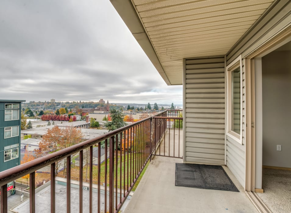 Private balcony with a terrific view of the neighborhood outside a model home at Verse Seattle in Seattle, Washington