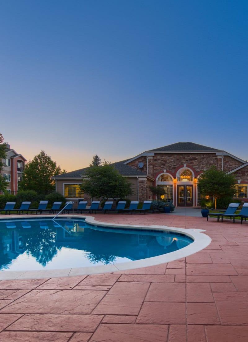 Pool at twilight at Whisper Creek Apartment Homes in Lakewood, Colorado