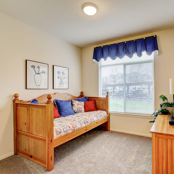 Secondary bedroom with a large window  for natural lighting at Laguna Creek Apartments in Elk Grove, California