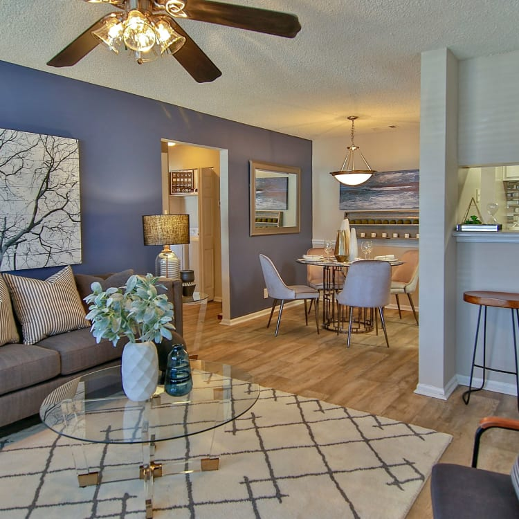 Well-decorated living area with hardwood floors in model home at Lyric on Bell in Antioch, Tennessee