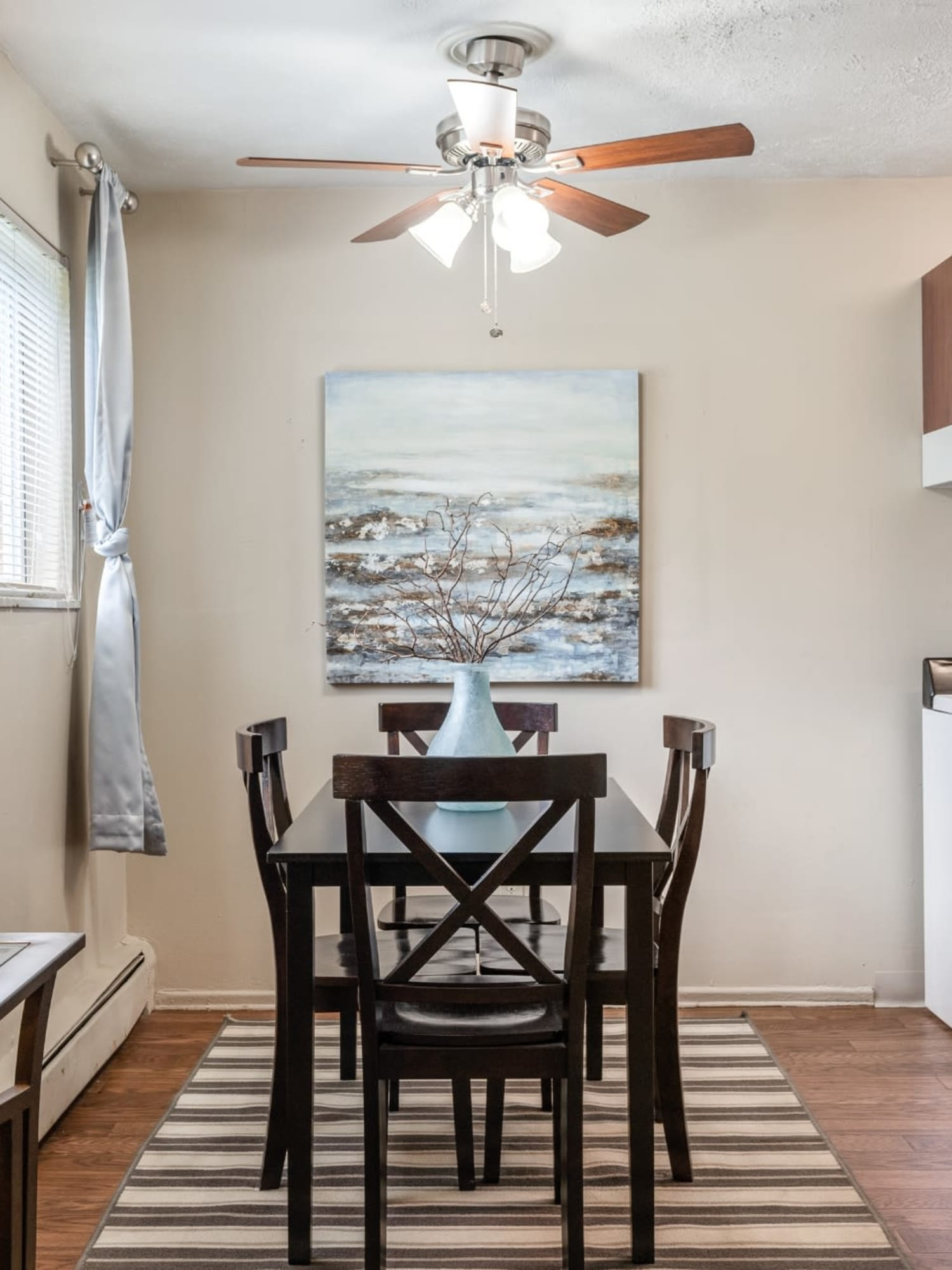 A spacious dining room with a ceiling fan at Centennial Woods Apartments in Cincinnati, Ohio