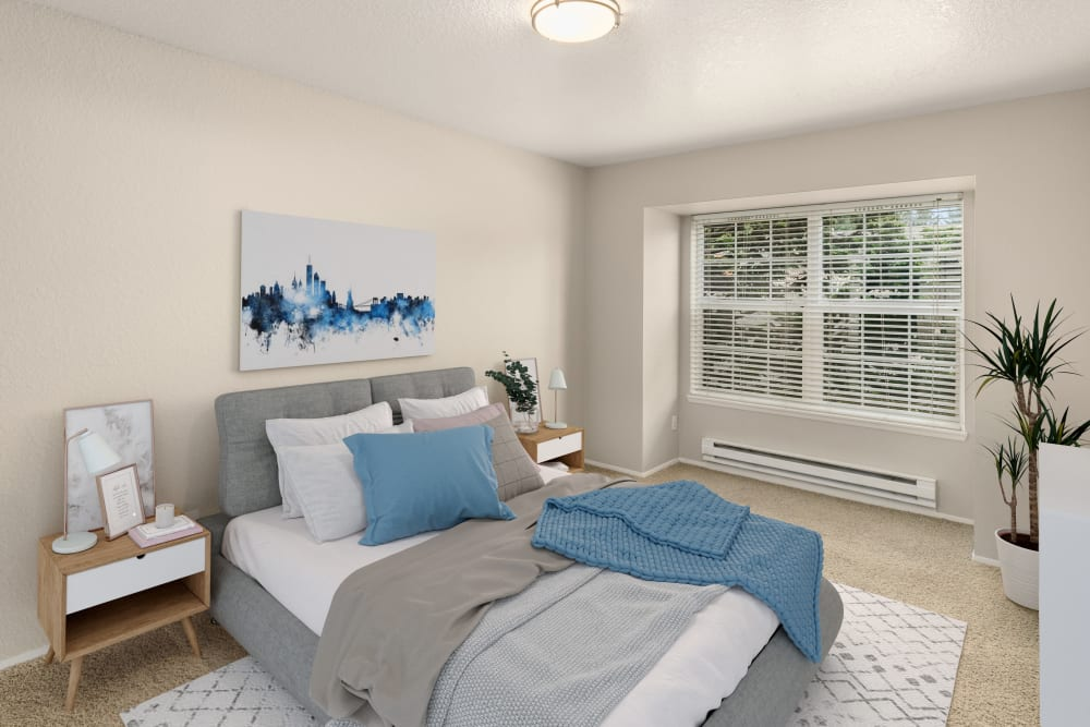 Spacious bedroom with natural light steaming in at Carriage Park Apartments in Vancouver, Washington