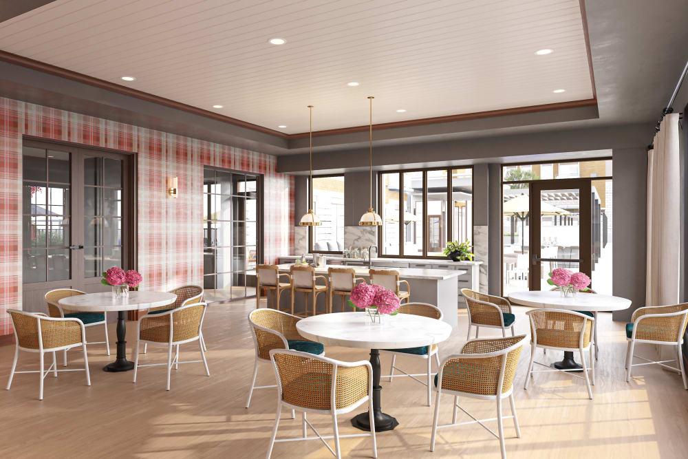 Cafe dining room with large storefront windows and hardwood flooring at Amira Minnetonka in Minnetonka, Minnesota