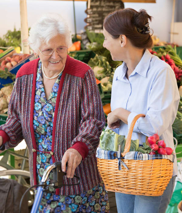 Resident and caretaker shopping at the grocery store near The Colonial at Historic Camden in Camden, South Carolina