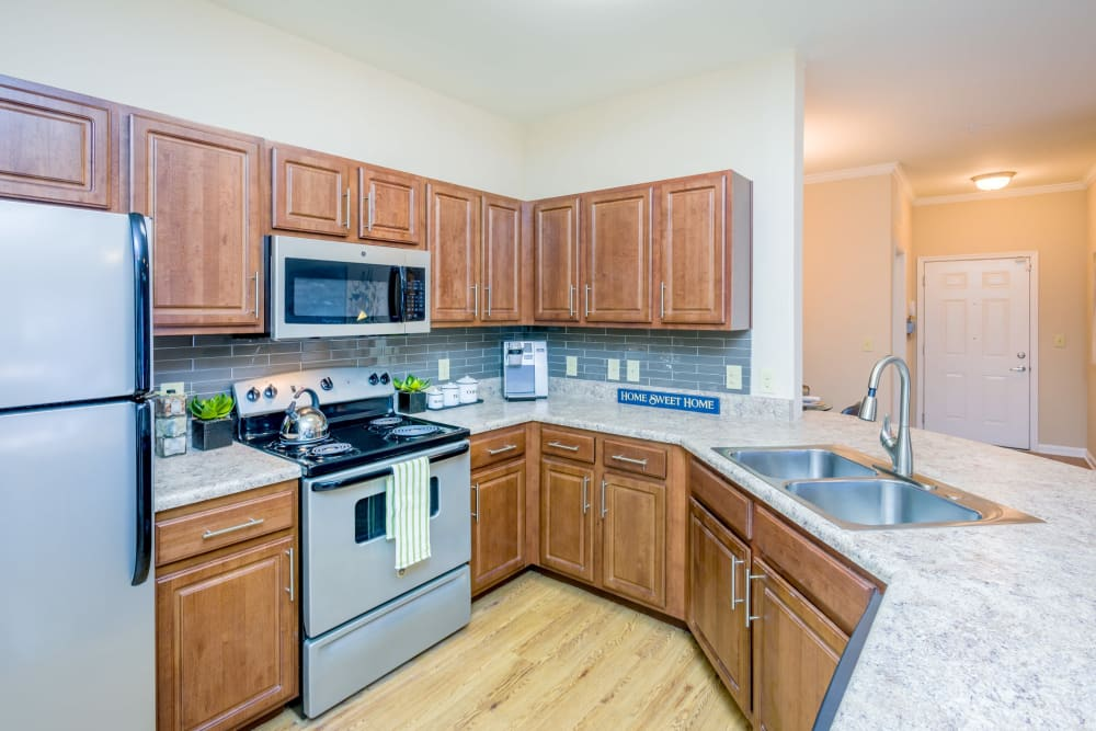 Beautiful kitchen layout with granite countertops at Arbor Village in Summerville, South Carolina