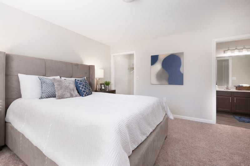 Carpeted bedroom with private bathroom at Ascend @ 1801 In Charlotte NC
