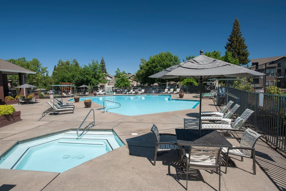Sundeck with a umbrellas for shade at Deer Valley Apartment Homes in Roseville, California