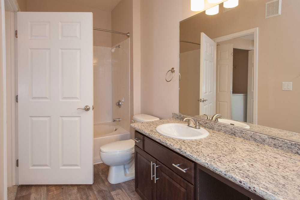 Model bathroom with unique accent lighting at The Vintage at South Meadows Condominium Rentals in Reno, Nevada