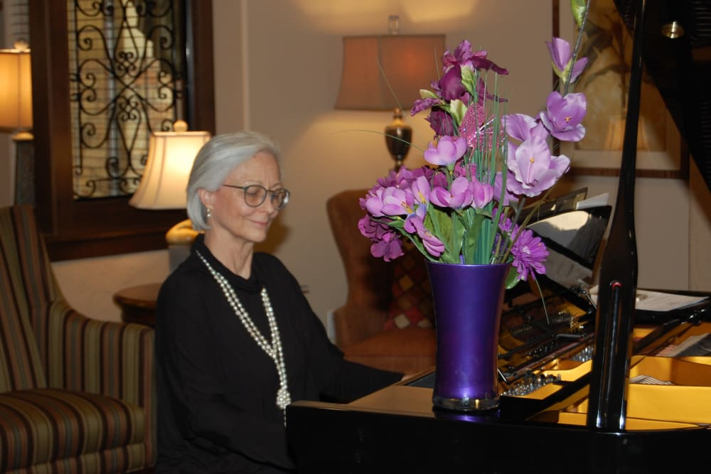A resident playing the piano at Merrill Gardens at Green Valley Ranch in Henderson, Nevada.