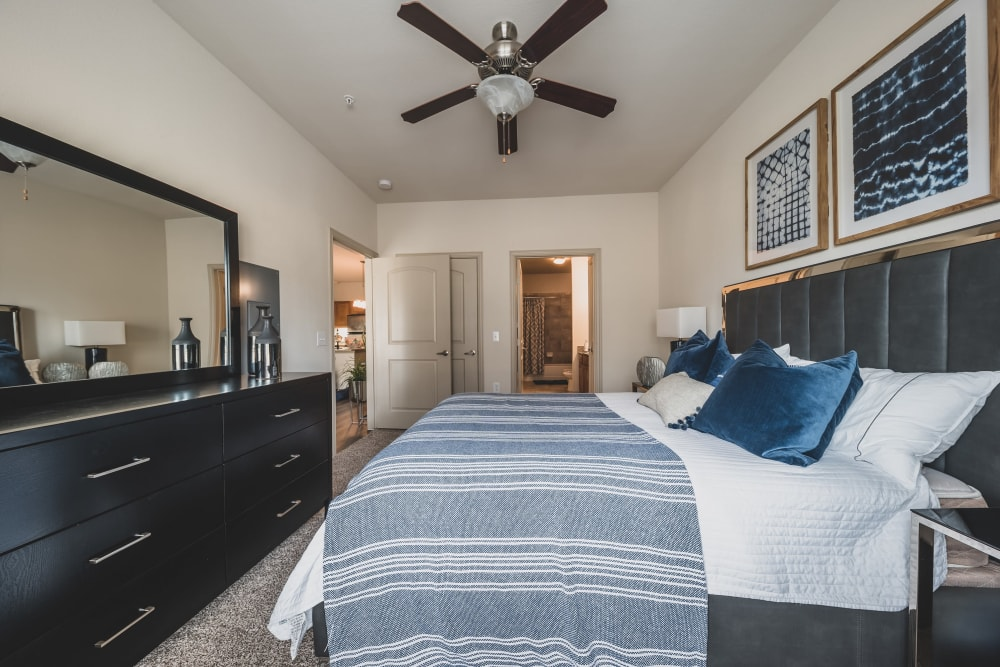 Bedroom with vanity mirror at Evolv in Mansfield, Texas