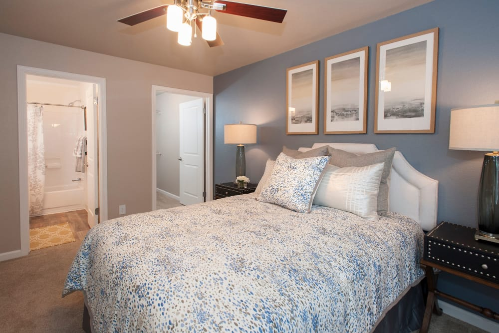 Master bedroom with ceiling fan at Reserve at Capital Center Apartment Homes in Rancho Cordova, California