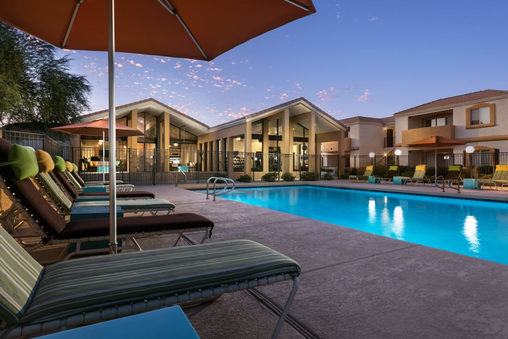 Beautiful swimming pool at dusk at Club Cancun in Chandler, Arizona