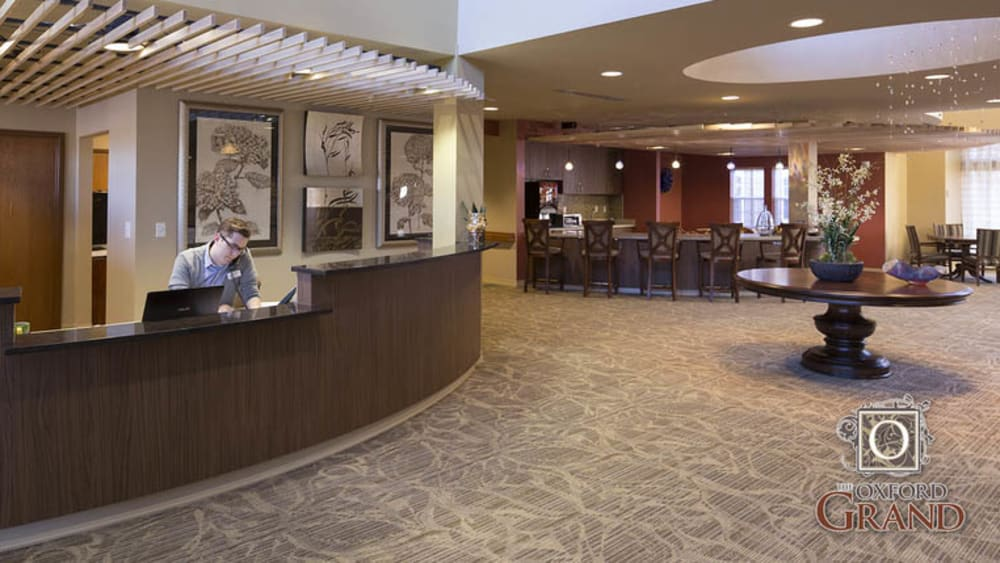 Reception area with a cafe in view at The Oxford Grand Assisted Living & Memory Care in Wichita, Kansas