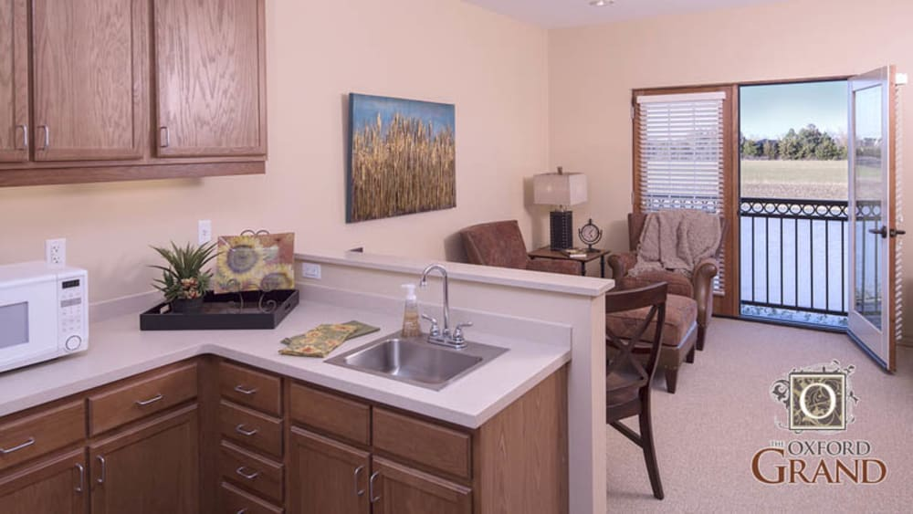 Kitchen in a studio apartment at The Oxford Grand Assisted Living & Memory Care in Wichita, Kansas