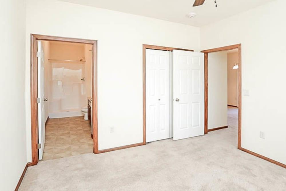Bedroom with en suite bathroom at Johnston Heights in Johnston, Iowa