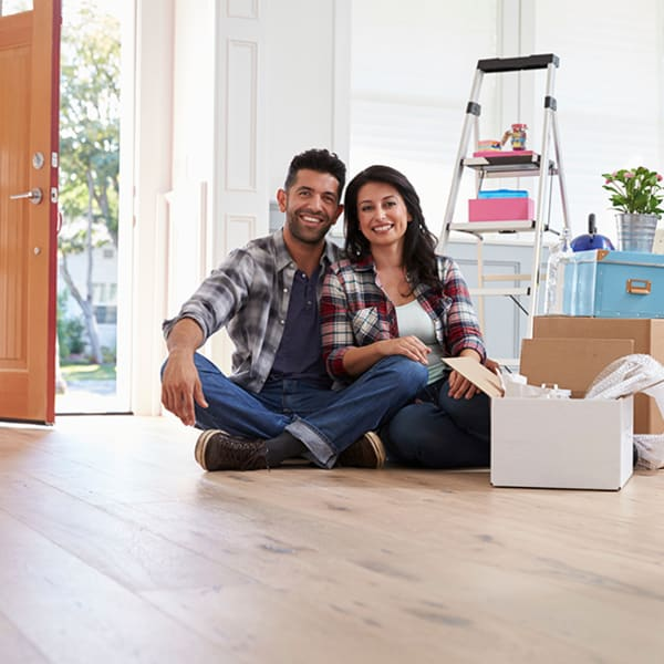 Man and woman packing boxes to go to Security Self-Storage