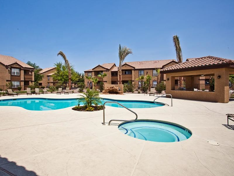 A pool and hot tub at Monterra Apartment Homes