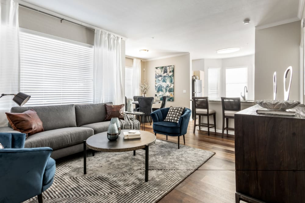 Expansive living area with wood-style flooring at The Links at Plum Creek in Castle Rock, Colorado