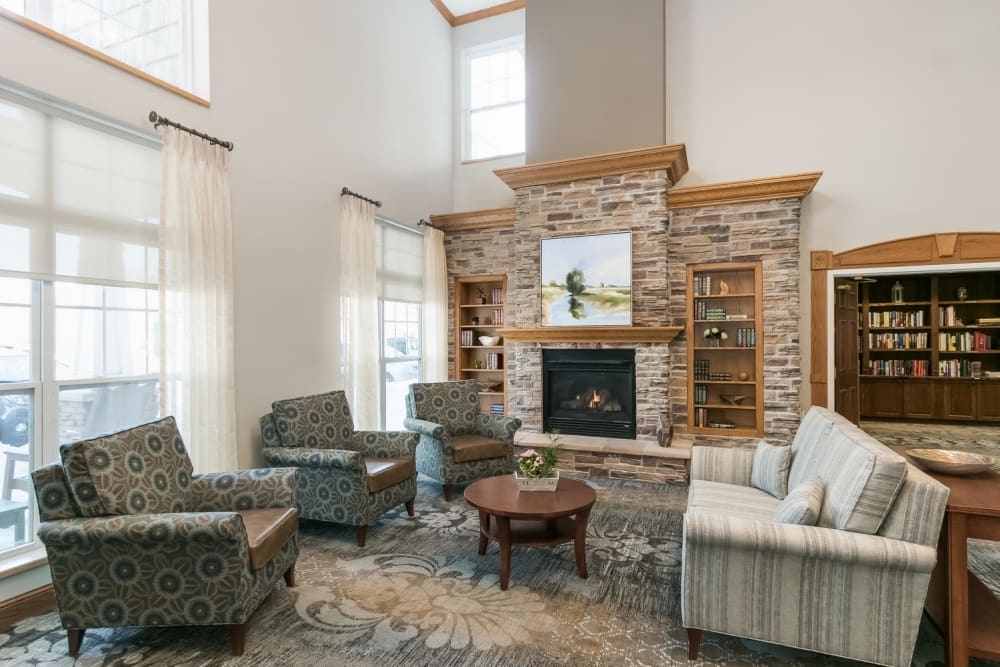Fireplace and seating area at Applewood Pointe of Roseville in Roseville, Minnesota.