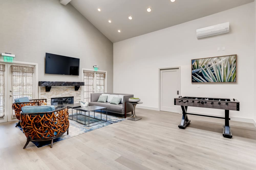 Large clubhouse with a fireplace at Hidden Hills Condominium Rentals in Laguna Niguel, California