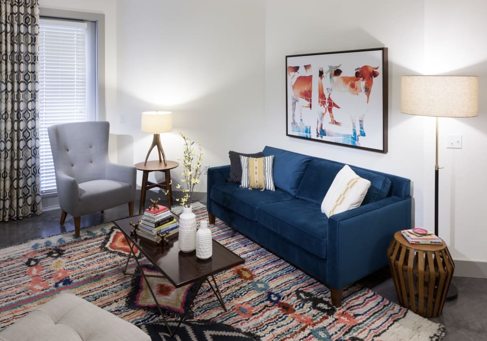 Enjoy a luxury living room at Maple District Lofts in Dallas, Texas