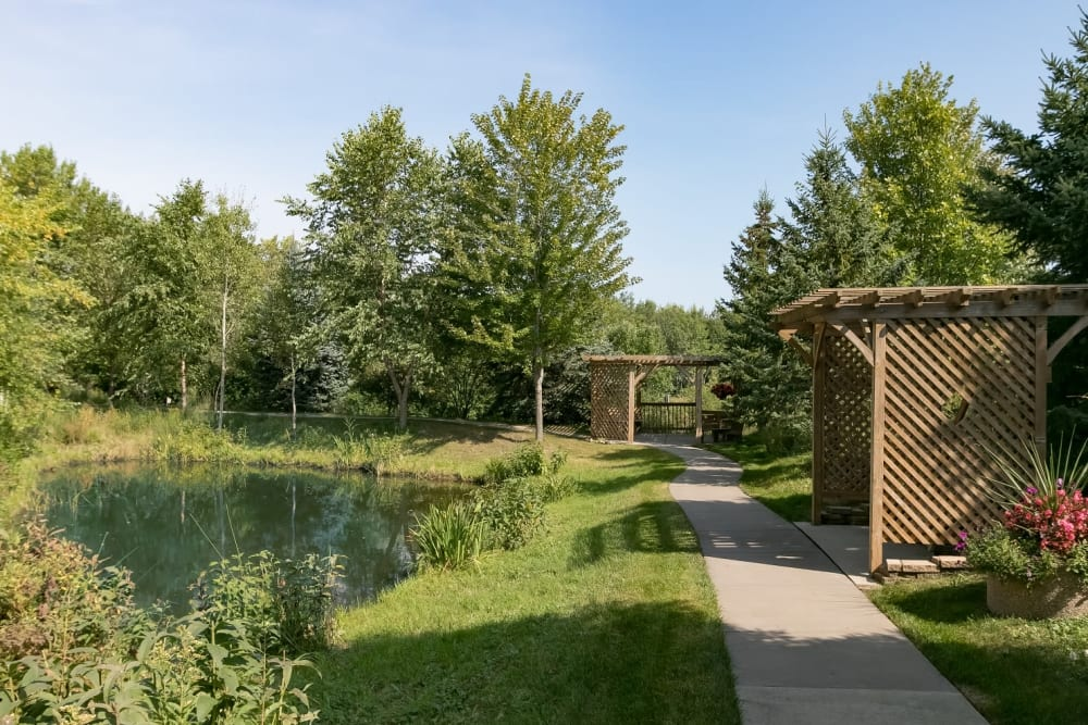 Lush landscaped grounds with pathway at Applewood Pointe Woodbury in Woodbury, Minnesota.