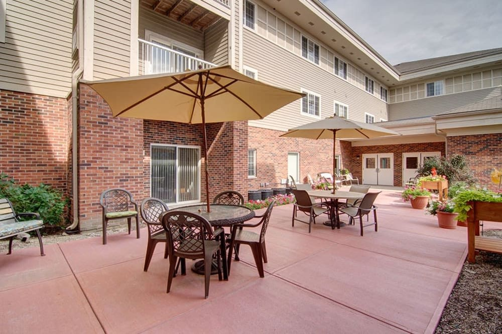 Back patio porch with seating at Randall Residence of McHenry in McHenry, Illinois
