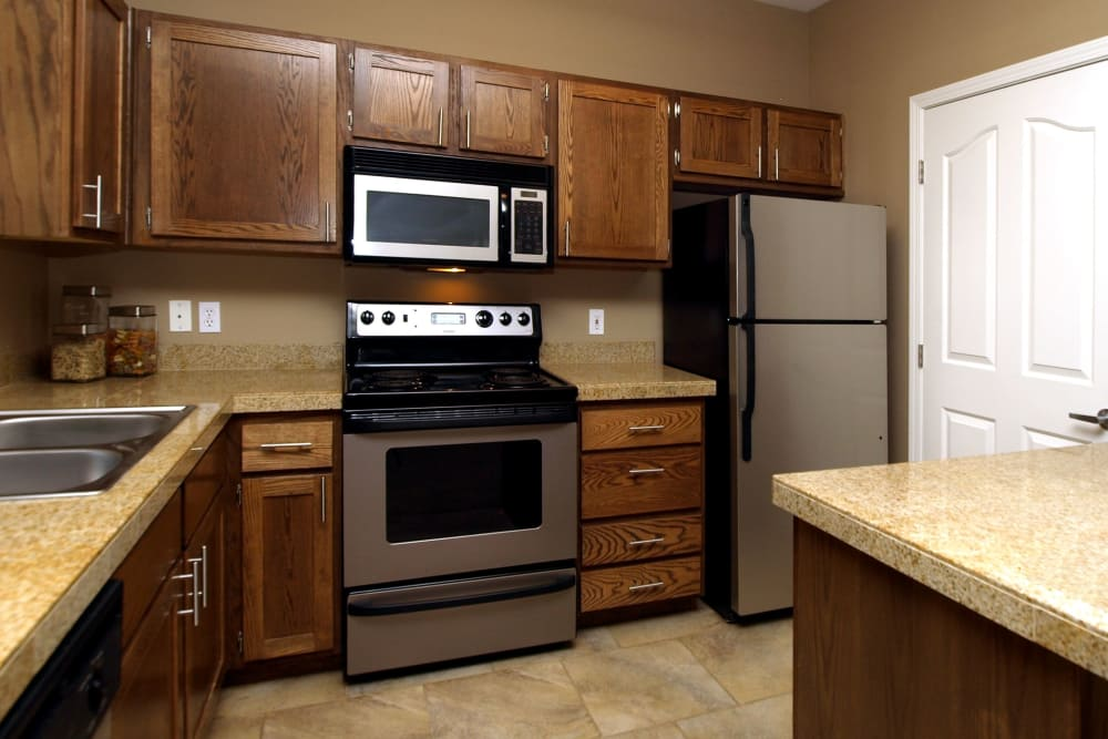 State-of-the-art kitchen with stainless-steel appliances at Cortland Village Apartment Homes in Hillsboro, Oregon
