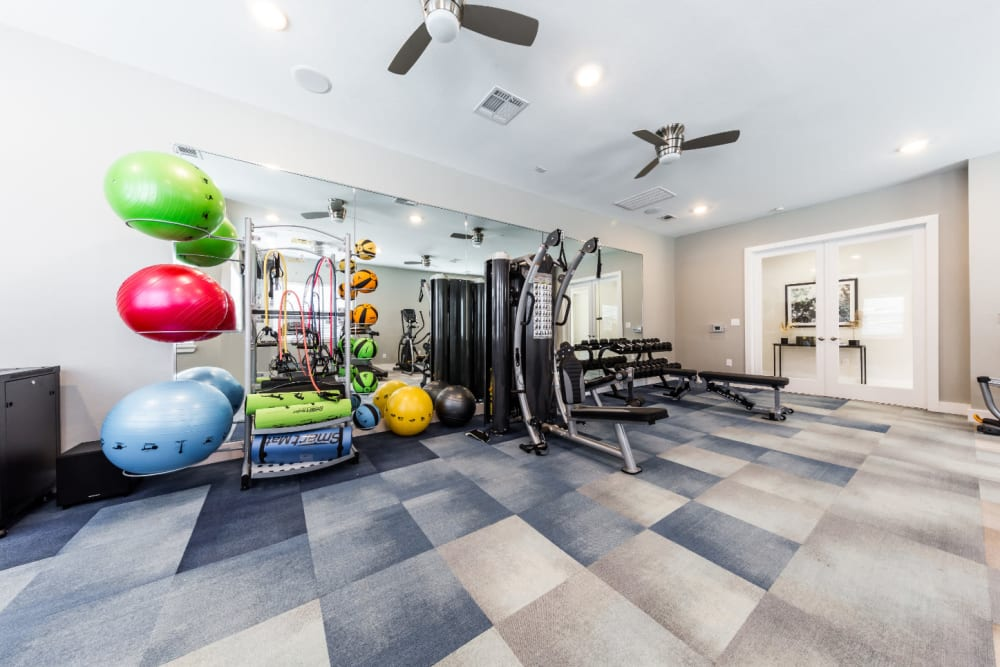 Fully equipped fitness center at Marquis at Cinco Ranch in Katy, Texas