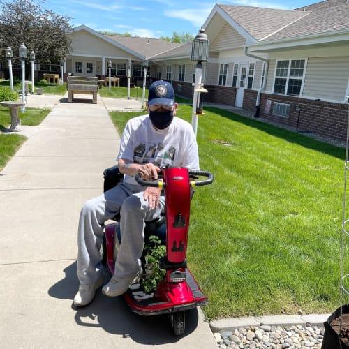 Resident on his scooter at Madison House in Norfolk, Nebraska