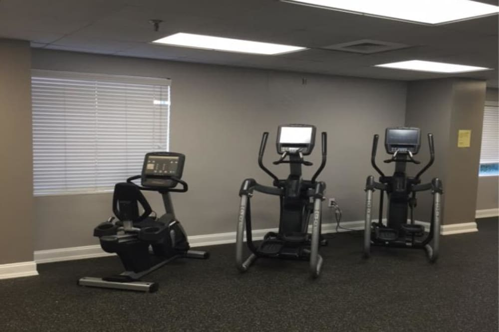 A resident gym with a variety of workout stations at Westwood Tower Apartments in Bethesda, Maryland