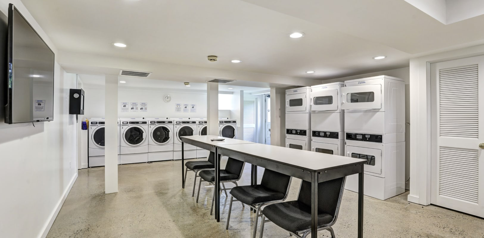 Community laundry room with plenty of machines at General Wayne Townhomes and Ridgedale Gardens in Madison, New Jersey