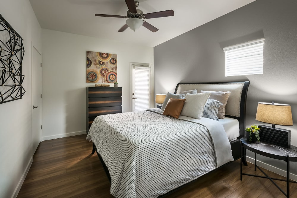 Modern decor in bedroom of model home at The Maxx 159 in Goodyear, Arizona