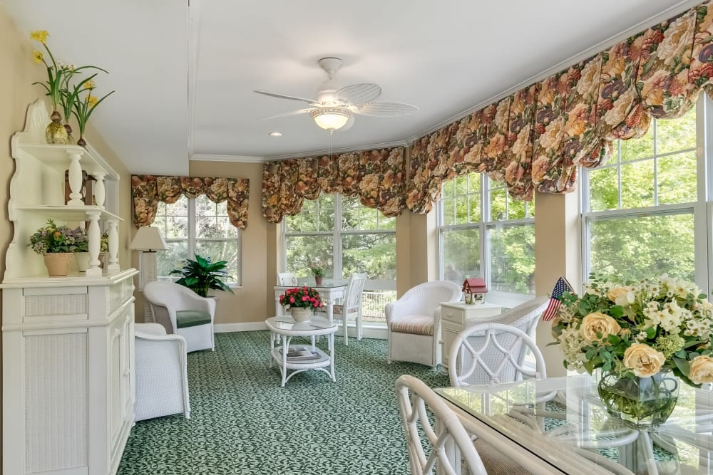 Sun room with large windows at Applewood Pointe Woodbury in Woodbury, Minnesota.