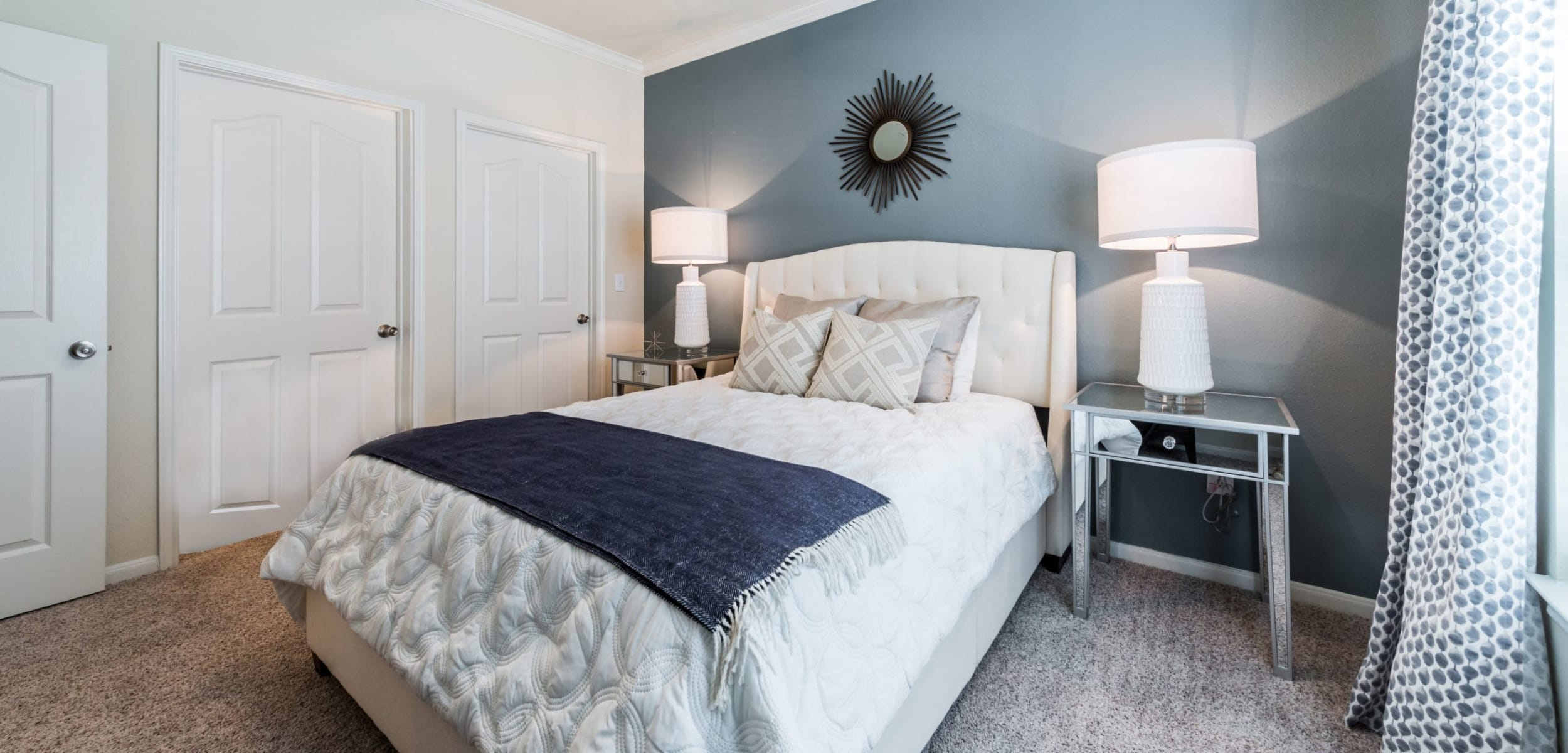 Bedroom with accent wall at Marquis at The RIM in San Antonio, Texas