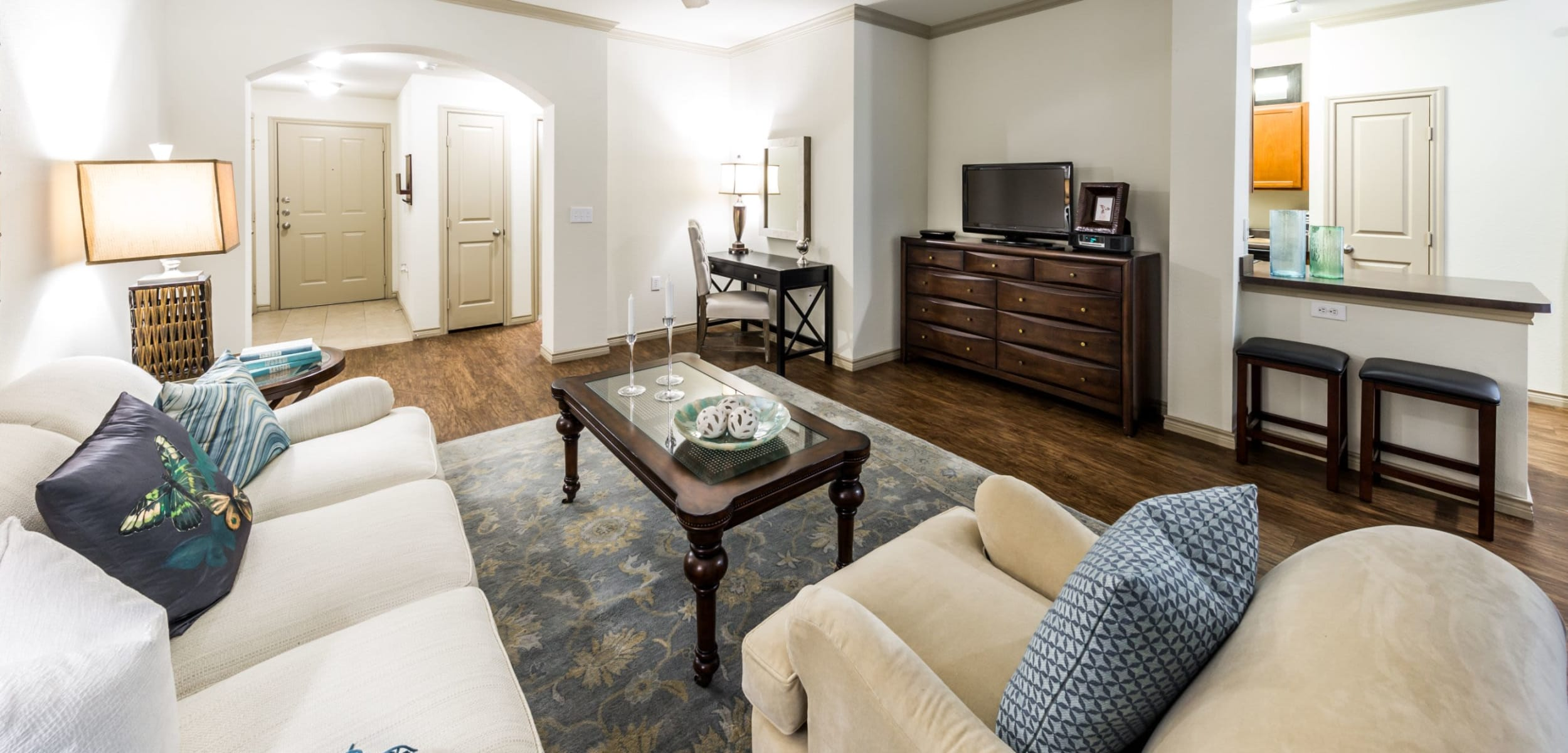 Living area with a breakfast bar and wood floors at The Marquis at Brushy Creek in Austin, Texas
