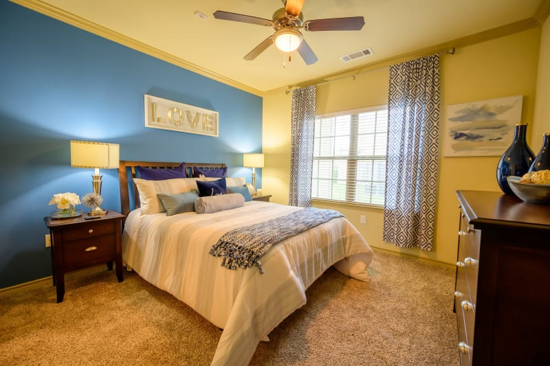 Bedroom with ceiling fan at Pecan Springs Apartments in San Antonio, Texas