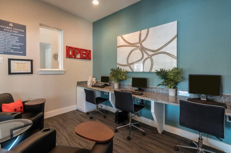 Office area for residents to use in the clubhouse at The Carling on Frankford in Carrollton, Texas