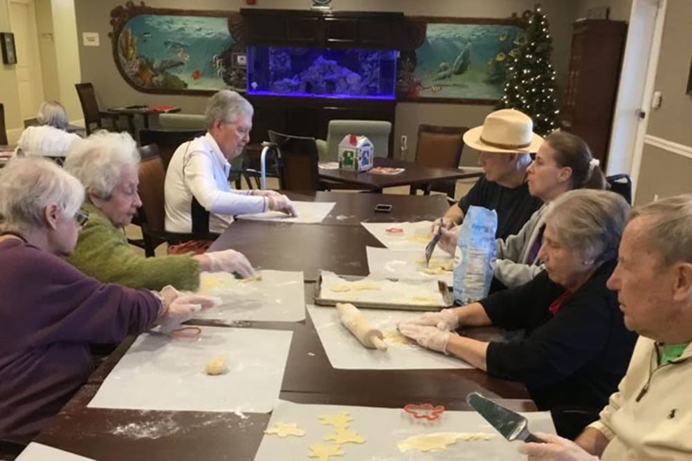 Residents making cookies at Inspired Living Hidden Lakes in Bradenton, Florida.