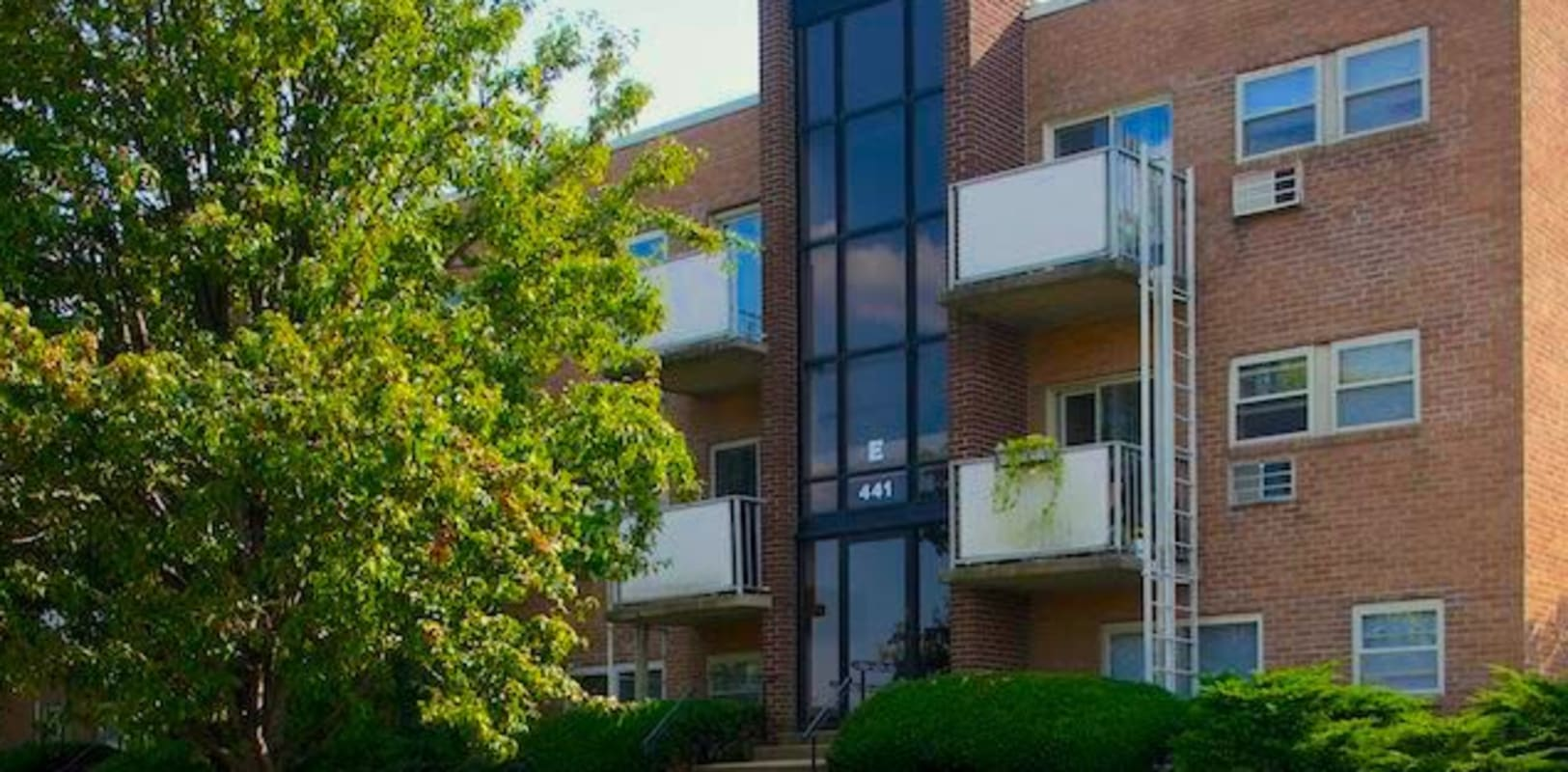 Exterior photo of a nice brick building at Marina Park Apartments in Collingswood, New Jersey