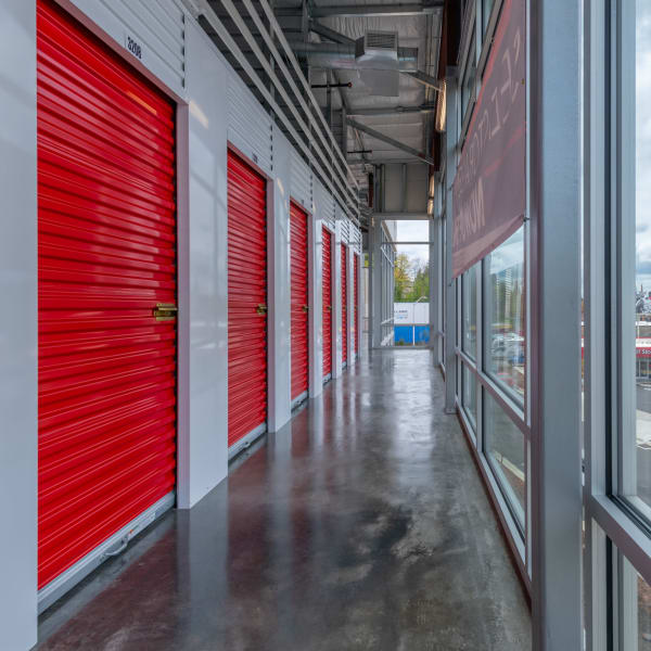 Climate controlled indoor units with red doors at StorQuest Self Storage in Portland, Oregon