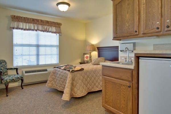 Assisted living apartment bedroom at Hartmann Village Senior Living in Boonville, Missouri