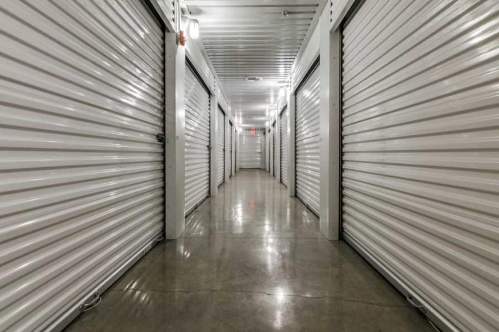 Well lit hallways at Advantage Storage - Garland Campbell in Garland, Texas.