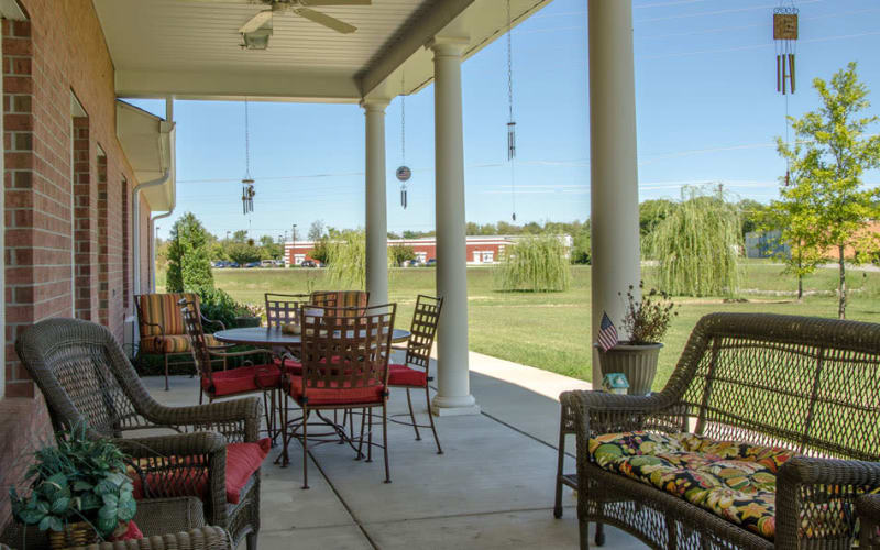 Outdoor patio with chairs at Azalea Court Senior Living in Smyrna, Tennessee