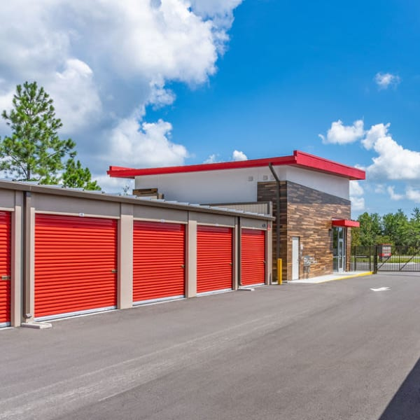 Red doors on outdoor units at StorQuest Express - Self Service Storage in Palm Coast, Florida